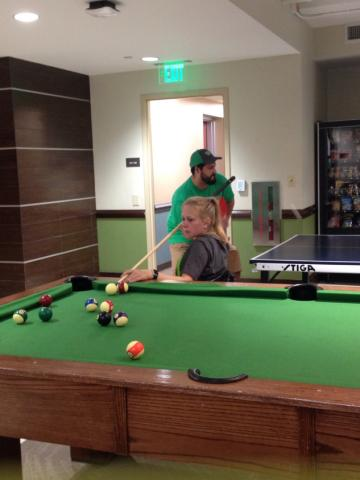 Participant playing pool at Rawlins Hall.