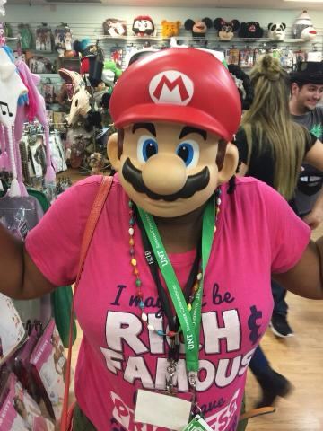 Participant wearing a Mario face mask at a local costume store.