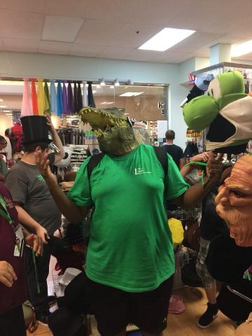 Participant wearing a alligator face mask at a local costume store.