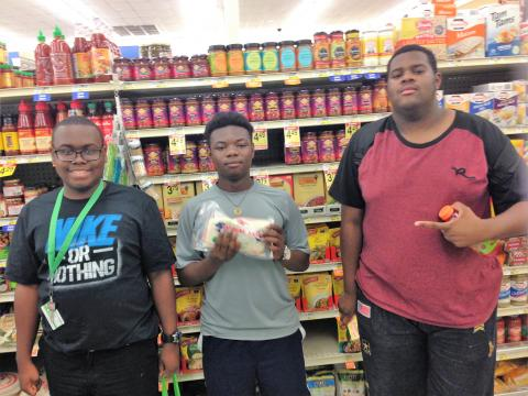 Three male participants grocery shopping.