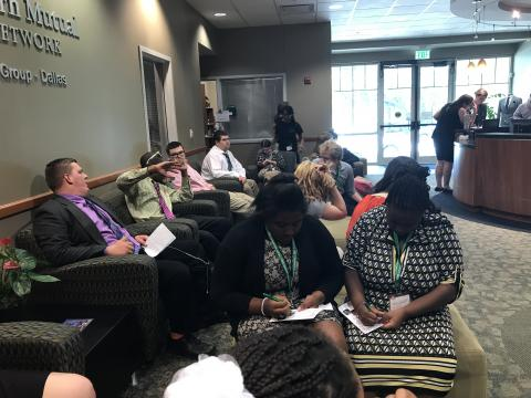 Participants seated in chairs at the UNT Career Center, dressed in interview clothing.