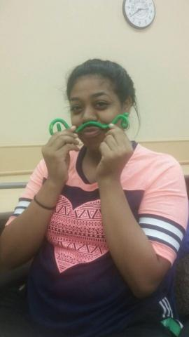 Participant making a mustache with a flexible manipulative.