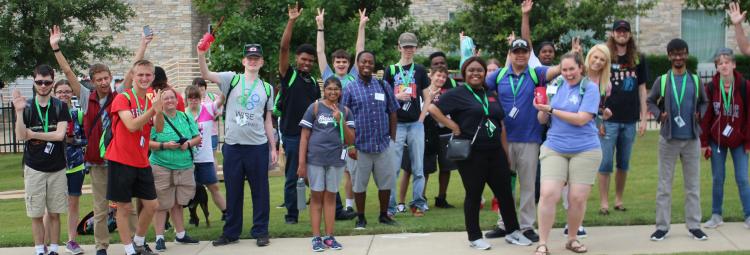 Image of summer program group photo on a sidewalk on UNT campus