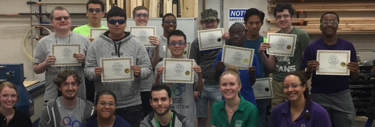 Image of summer camp students with their completion certificates